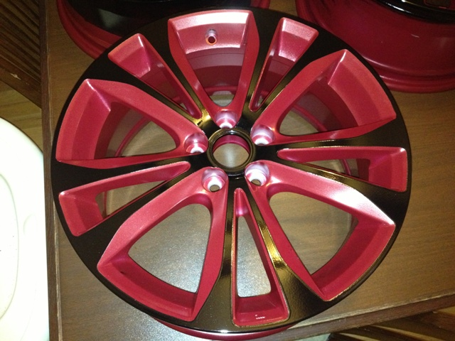 black powder coated wheels with toreto red insets