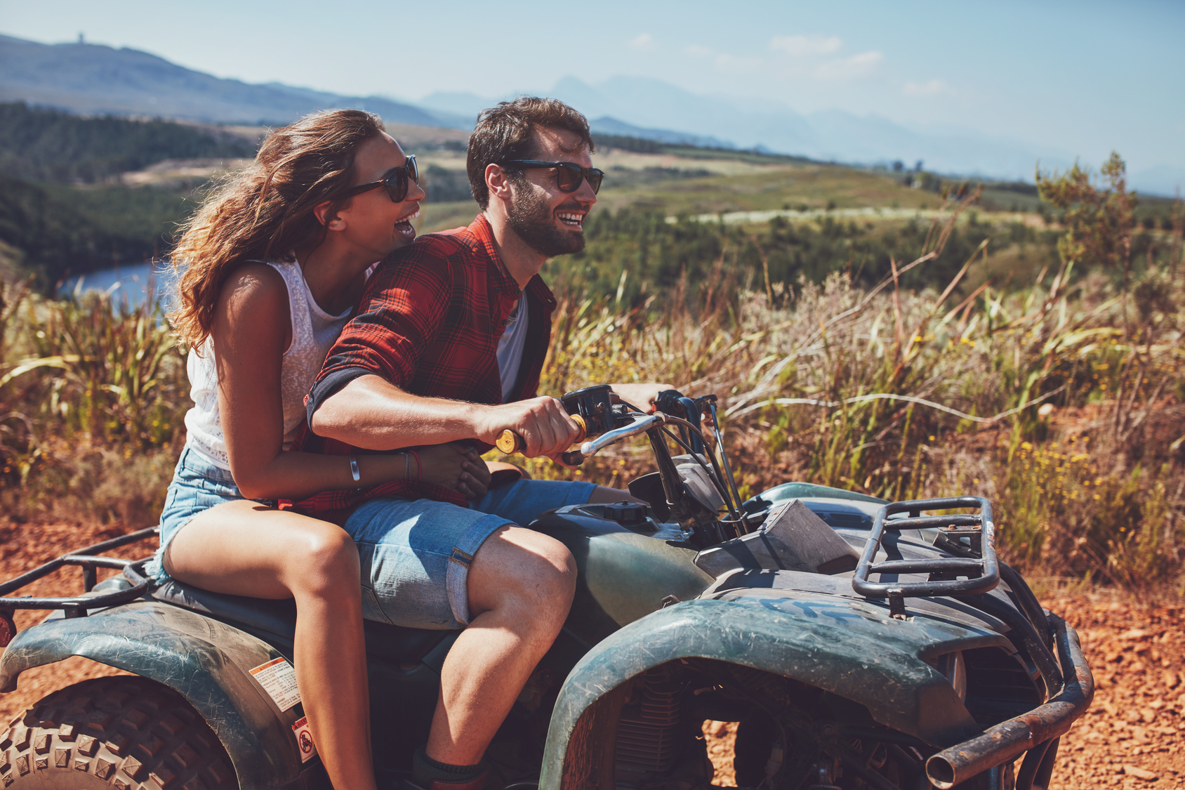 Couple outdoors on an ATV